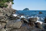 Black volcanic stones with a watersplash along the coastline of Seogwipo, Jeju Island, South Korea