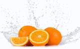 Fresh oranges with water splash