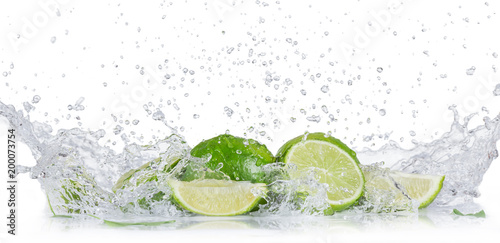 Fresh limes with water splash