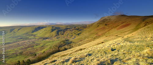 Spring Sunrise on Mam Tor overlooking Edale and the Hope Valley after a clear night with a light dusting of snow - 200075184