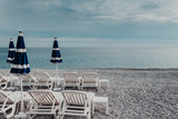 Season, summer vacation concept. Panoramic view of beautiful seascape with deck chairs and umbrellas. Many seashels. Beautiful sunny summer day - 200088942