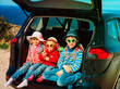 happy kids- little boy and girls- enjoy travel by car at beach