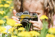Baby girl taking pictures outdoors - 200104919