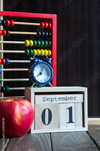 School stationery next to chalkboard on the wooden desk. Back to school concept - 200106781