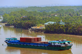 Self-propelled bulk cargo barges anchored on river.