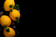 Lemons isolated on the black background. Top view - 200114329