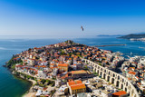 Aerial view the city of Kavala in northern Greek, ancient aqueduct Kamares, homes and medieval city wall - 200119121
