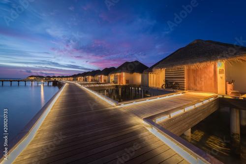Foto Murales wood bangalow over seawater