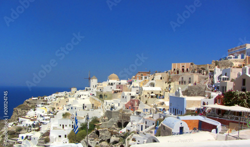 Keuken foto achterwand Santorini Oia town on Santorini island, Greece. Traditional and famous houses and churches with blue domes over the Caldera, Aegean sea