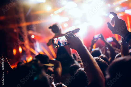 Portrait of happy crowd enjoying at music festival - 200128325