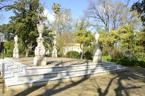 Stone architectural columns in park of Seville, Spain