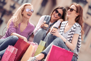 Group of friends resting after shopping