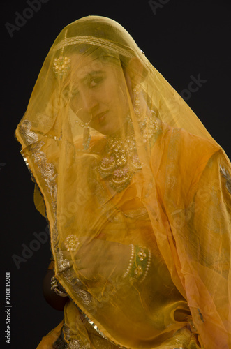 Foto Murales Young woman in bridal costume and jewelry, India