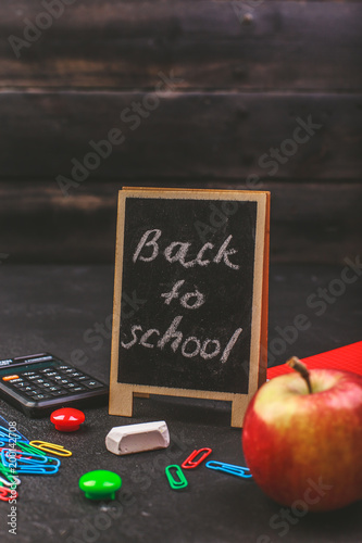 School supplies on black board background colorful back to school - 200142708