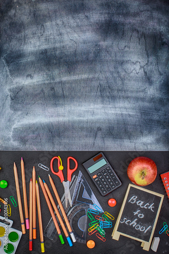 School supplies on black board background colorful back to school - 200143106