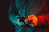Smartphone in male hands, close up