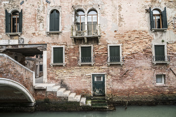 Ancient house on a canal in Venice, Italy.
