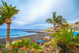 People enjoying summer holiday on Arena beach of Tenerife, Canary island of Spain