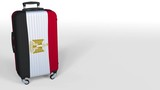 Traveler's suitcase featuring flag of Egypt. Egyptian tourism conceptual animation, blank space for caption - 200164993