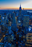 New York City skyline at night - skyscrapers of midtown Manhattan with Empire State Building at Amazing Sunset - USA © Simon Dannhauer