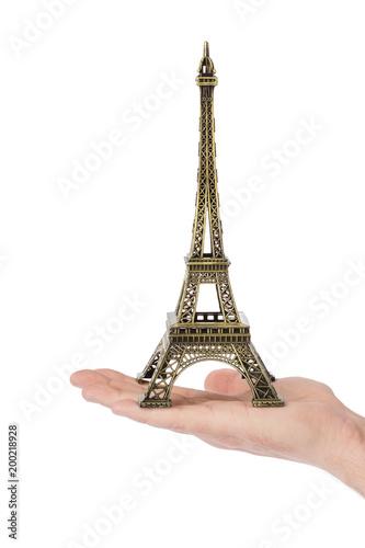 Wall mural Paris Eiffel tower souvenir in hand