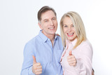 Happy middle aged couple in embraces and show thumb up. - 200228715