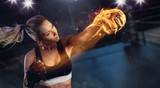 Young blond woman with fire fist - 200229741