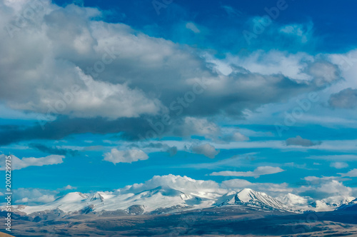 Foto op Plexiglas Blauwe jeans Mountain landscape with clouds. Mountain valley. The Altai mountains. Travel adventure vacation background