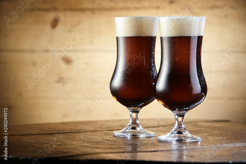 Foto Murales Chalices of brown ale beer with thick foam