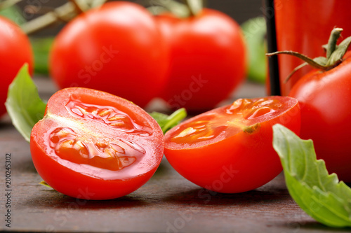 Fotobehang Sap Tomato juice with vegetables and basil on wooden background