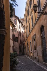 Typical old and narrow street in Rome, Italy