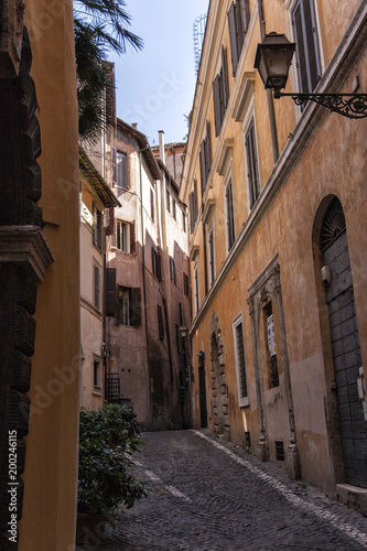 Typical old and narrow street in Rome, Italy - 200246115