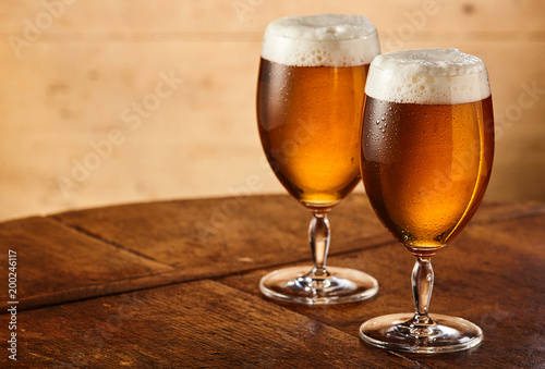 Two stemmed glasses of fresh draft or craft beer - 200246117
