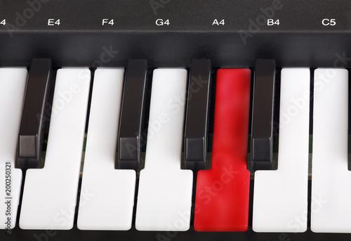 piano keyboard macro with red key - 200250321