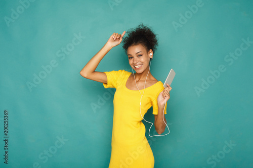 Woman enjoying music in earphones