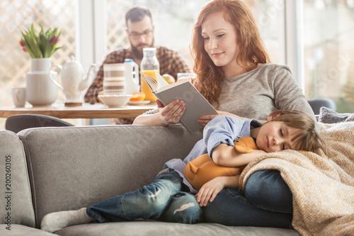 Leinwandbild Motiv Son lying on mother's laps