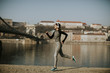 Young female athlete running on the waterfront in Budapest, Hungary