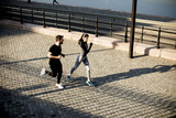 Healthy runners running in the city with cityscape background - 200266932