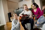 Friends having fun with guitar - 200267772