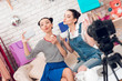 Постер, плакат: Two fashion blogger girls drink tea with marshmellows to camera