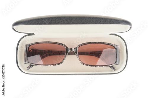 Sun eyeglasses in case isolated on white background