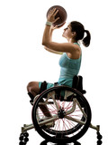 one caucasian young handicapped basket ball player woman in wheelchair sport  tudio in silhouette isolated on white background - 200280573
