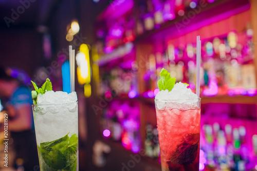 Glasses alcohol color cocktails on bar background - 200281929