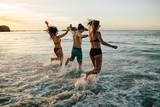 Friends having fun at the beach - 200285122