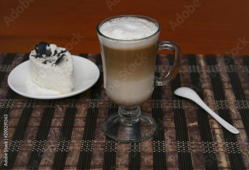 Foto op Aluminium Koffiebonen cappuccino in a beautiful glass