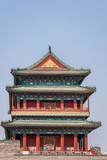 Beijing, China - April 27, 2010: Upper Structure in pagoda-style traditional architecture of Qianmen, Southern Gate, at edge of Tiananmen Square against blue sky. Reds, blues and gold.