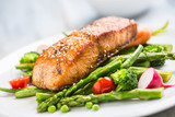 Roasted salmon steak with asparagos broccoli carrot tomatoes radish green beans and peas. Fish meal with fresh vegetable - 200294385