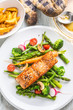 Roasted salmon steak with asparagos broccoli carrot tomatoes radish green beans and peas. Fish meal with fresh vegetable - 200294909