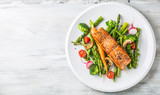 Roasted salmon steak with asparagos broccoli carrot tomatoes radish green beans and peas. Fish meal with fresh vegetable - 200294926