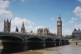 Big Ben near a bridge.